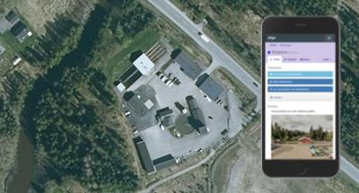 Ilmakuva Nivosveden jätevesipuhdistamosta. Kuvaan upotettu mobiilinäyttökuva AHJO-järjestelmästä.